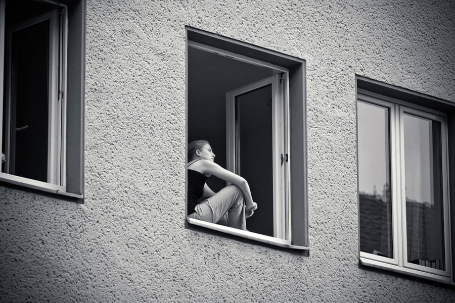 photograph of women in apartment window