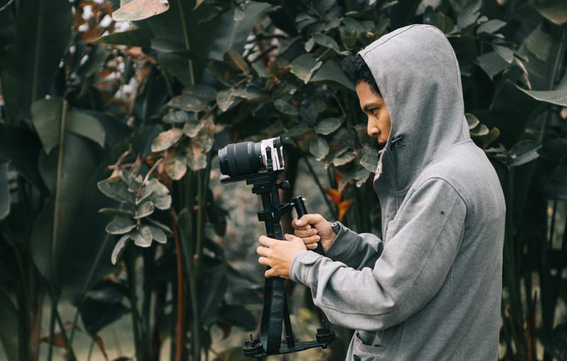 man with camera in forest