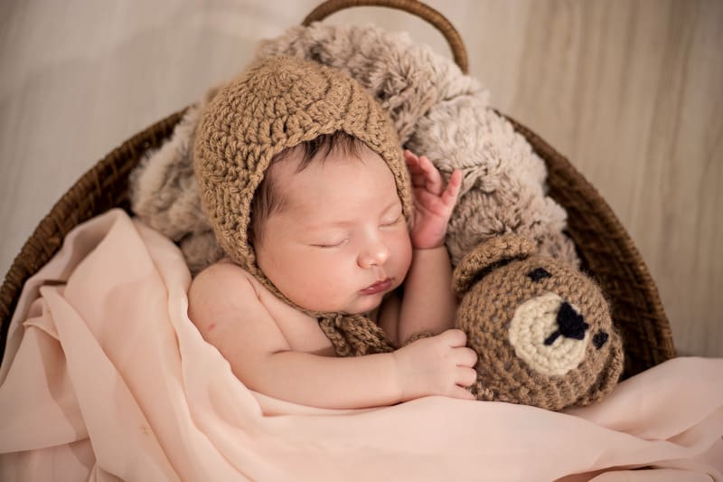 baby in knit hat sleeping