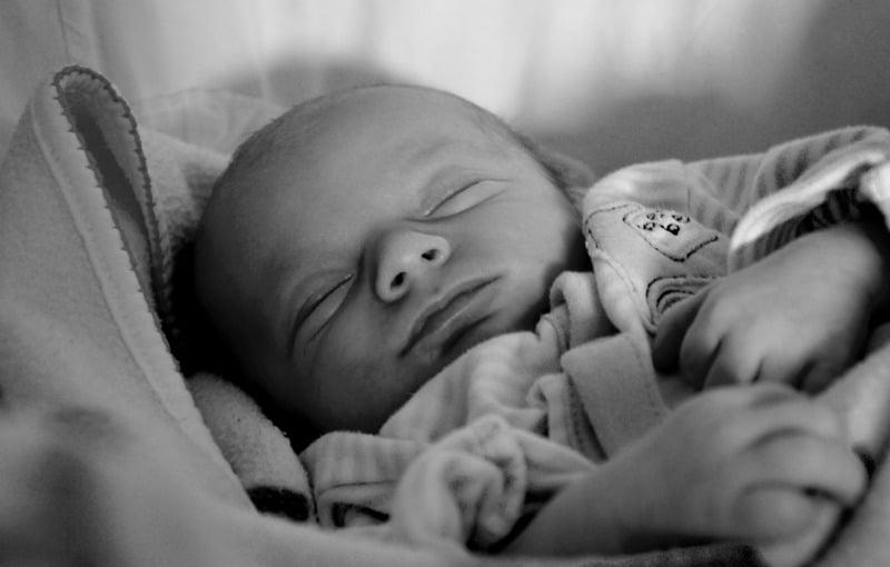 black and white photo of baby