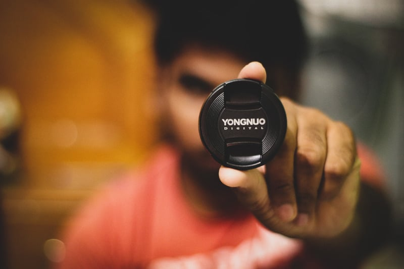 man holding yongnuo flash