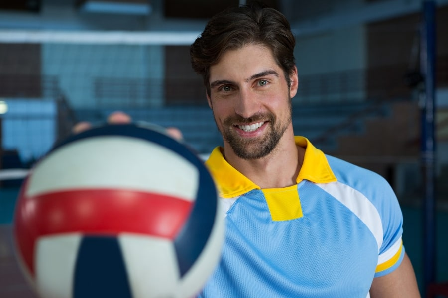 man holding volleyball