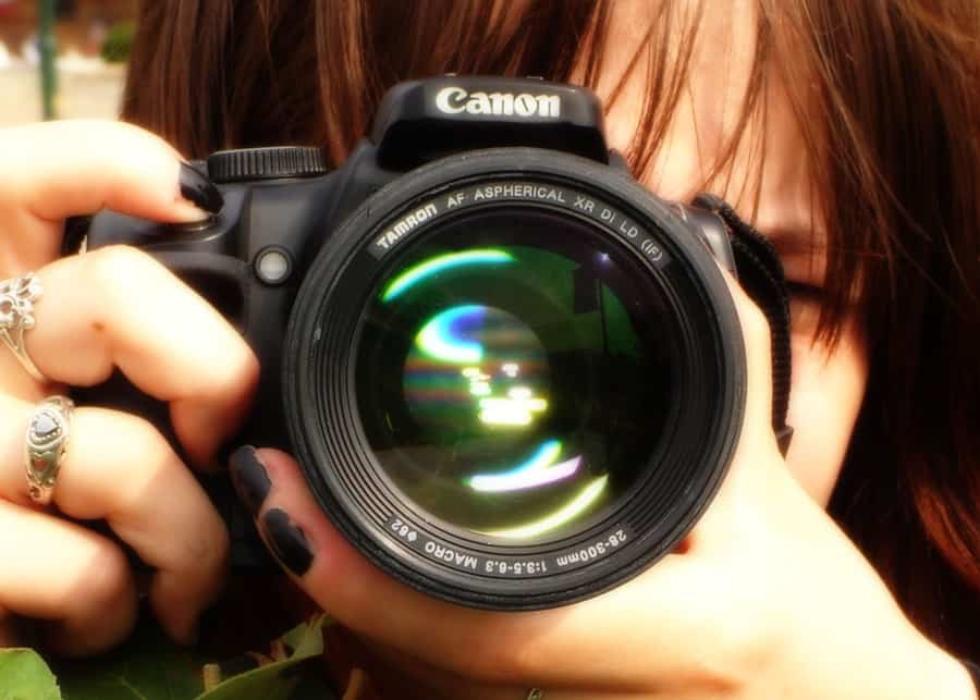 closeup of woman holding a camera up to her eye