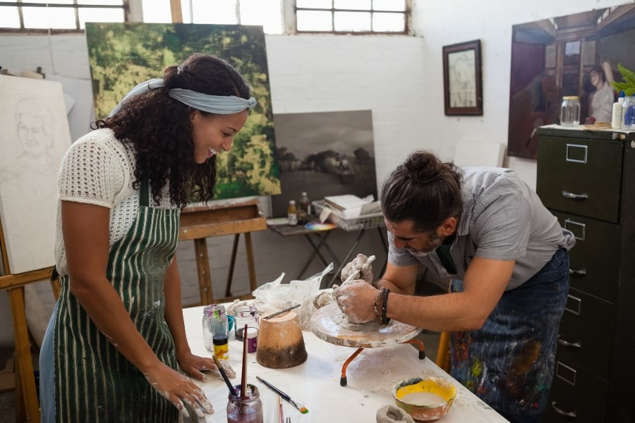 couple in ceramics studio