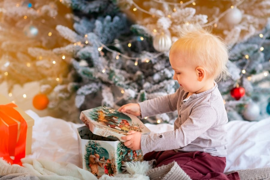 baby opening christmas present
