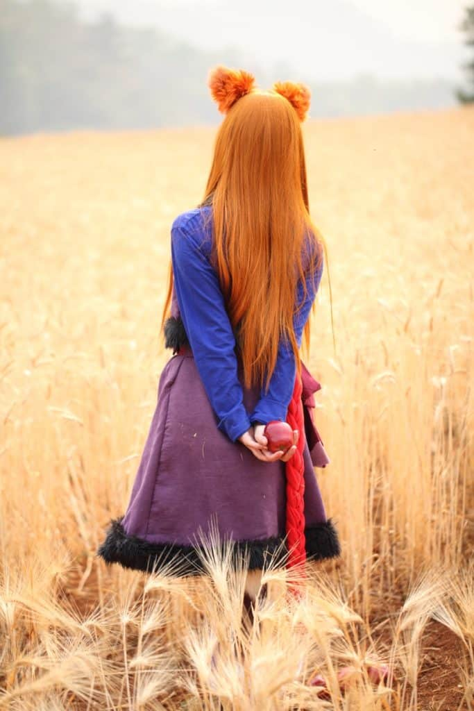 cosplayer standing in wheat field