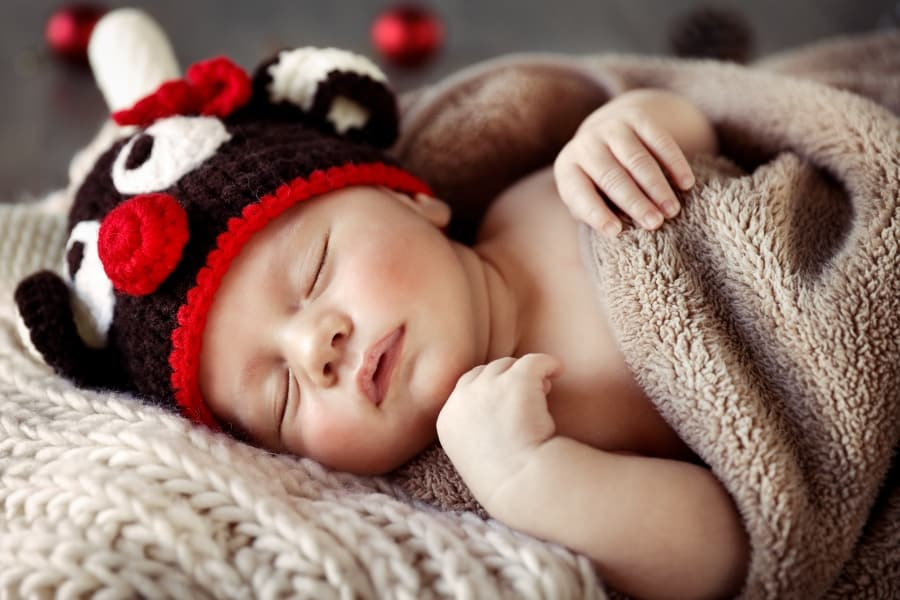 baby sleeping with knit cap on