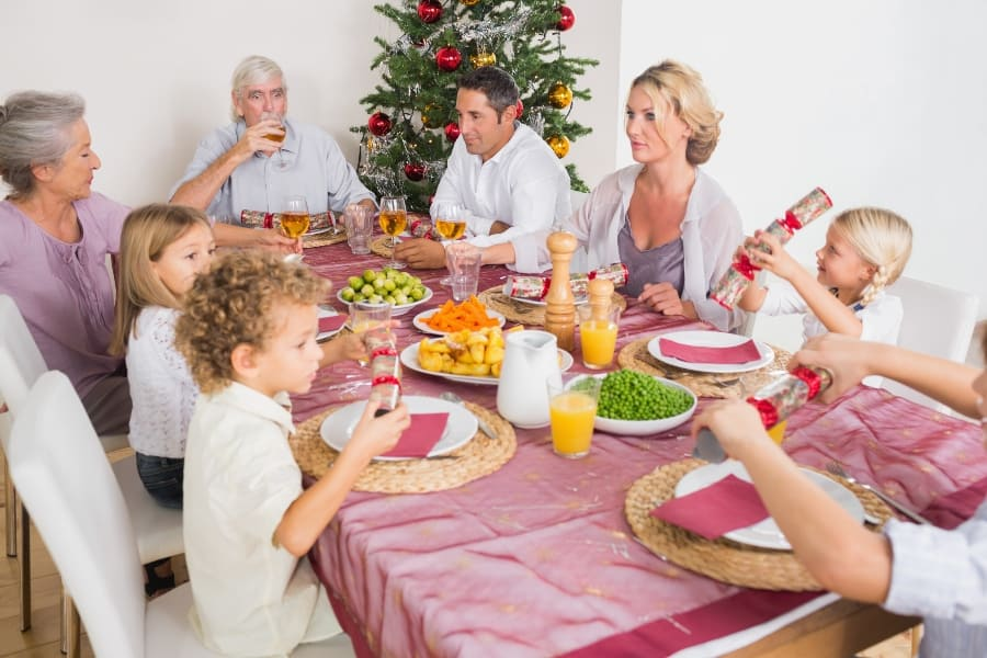 family eating dinner together at christmas