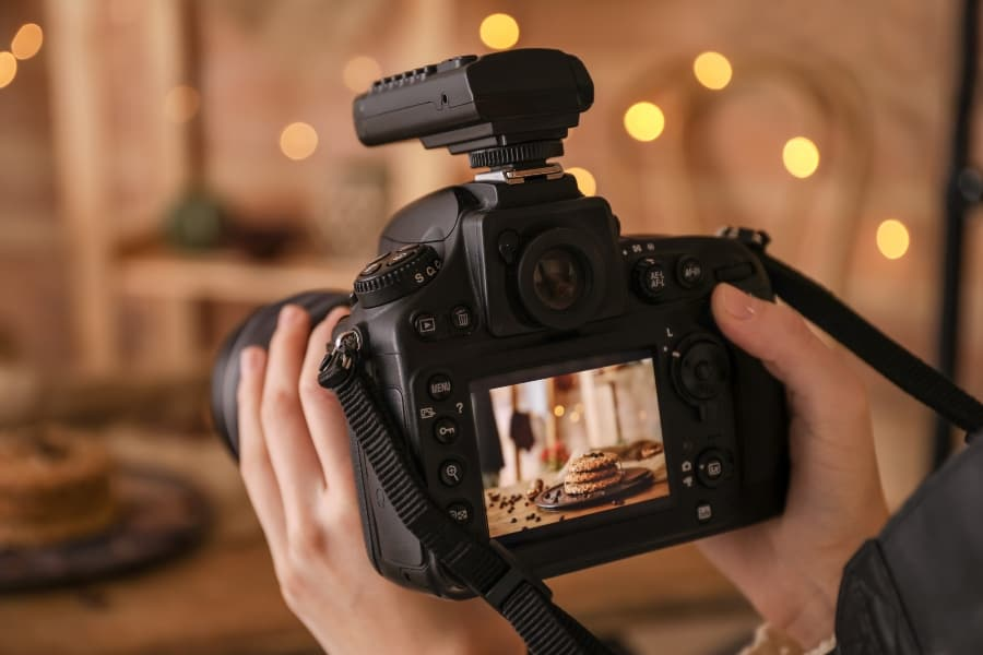 food photographer with cake in frame
