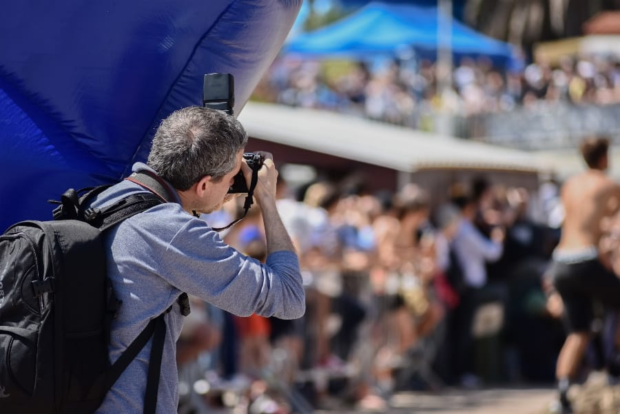 man photographing sporting event