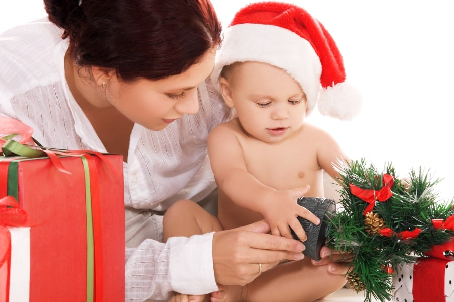 baby opening present with mother