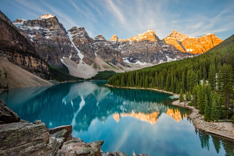 moraine lake with mountains in background