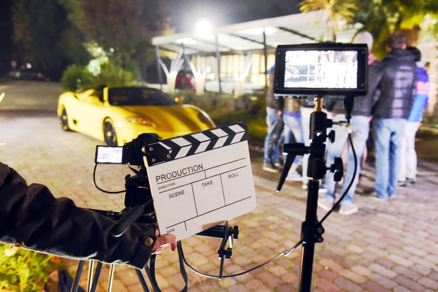 movie set with car and camera