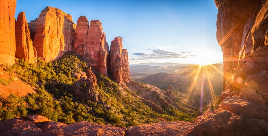 sun rising over majestic canyon