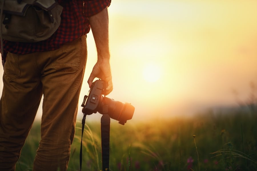 travel photographer with camera