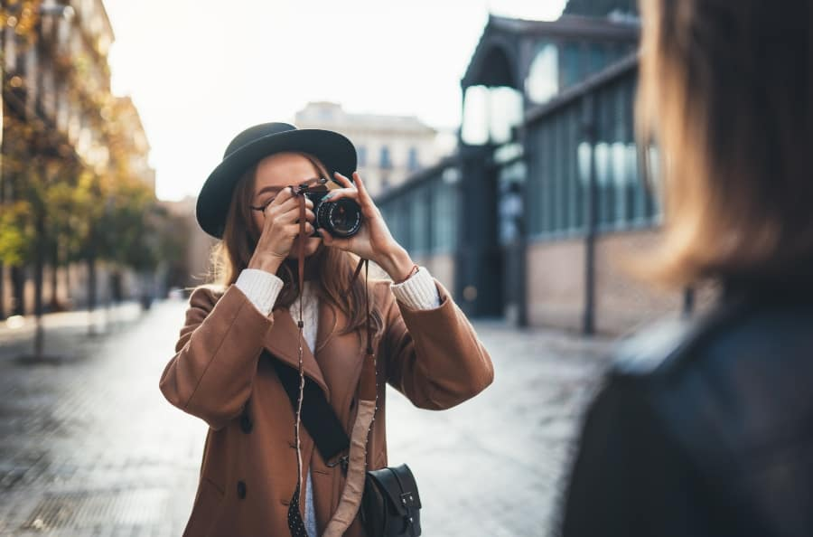 woman taking picture of friend