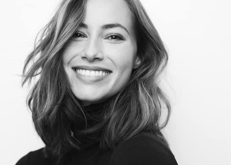 black and white headshot of woman smiling