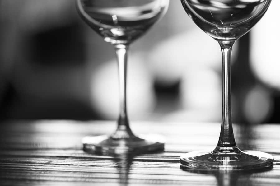black and white photo of two wine glasses