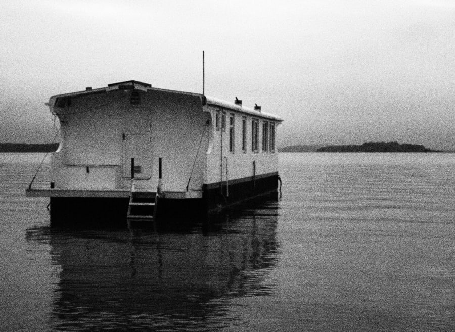 grainy black and white photo of boat