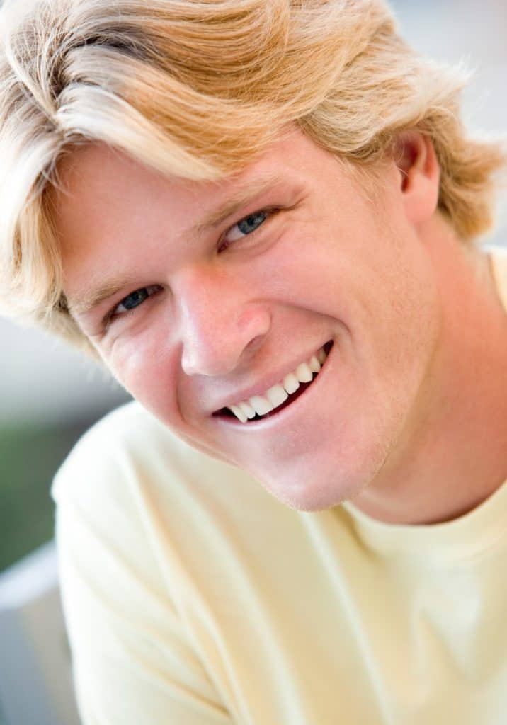 man smiling in a head shot