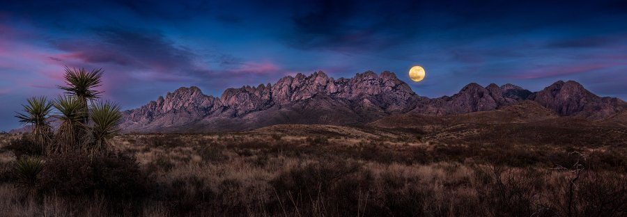 moon rising over mountain in dessert