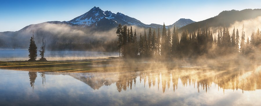 morning mist over mountain and lake