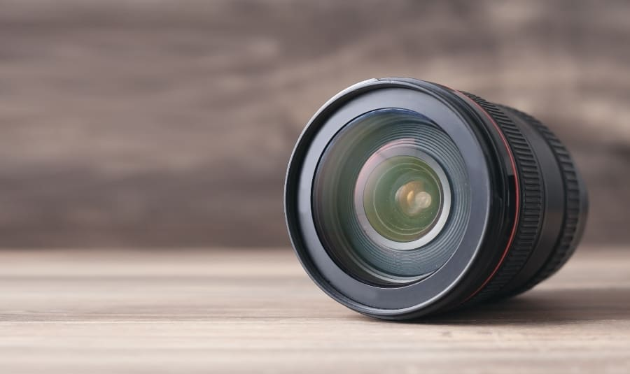 canon camera lens on table