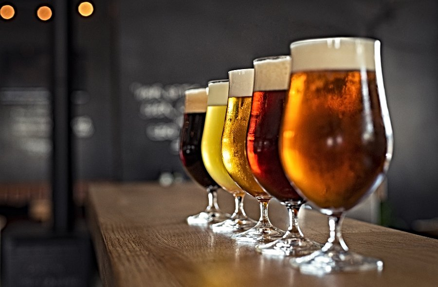 line of craft beers in glasses